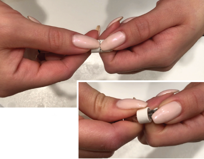 <p>Figure 1. In the real world, removing the cap of a PFS can compromise sterility when the user's hands are large or gloved or the fingernails are long.</p>
