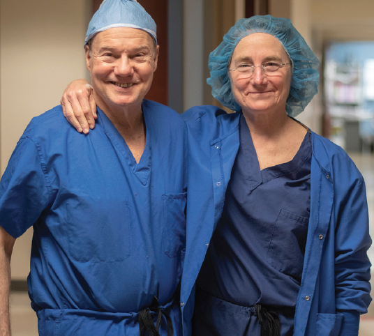 <p>Drs. Carol and Jerry Shields paused for a picture in the Wills Eye Hospital OR.</p>