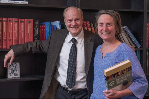 <p>Drs. Carol and Jerry Shields with a copy of Intraocular Tumors: An Atlas and Textbook, Second Edition, which they coauthored. The book's third edition was released in 2016.</p>